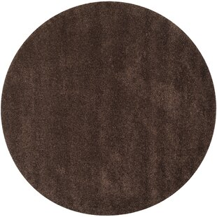 Rowen Hand-Tufted Brown Area Rug by Wade Logan