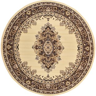 Britain Ivory Area Rug by World Menagerie