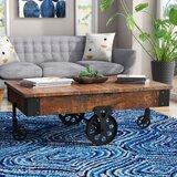 https://secure.img1-fg.wfcdn.com/im/41726132/resize-h160-w160%5Ecompr-r85/6028/60287835/Gordillo+Wheel+Coffee+Table.jpg