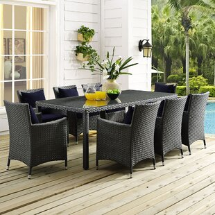 Tripp 9 Piece Dining Set with Sunbrella Cushions by Brayden Studio