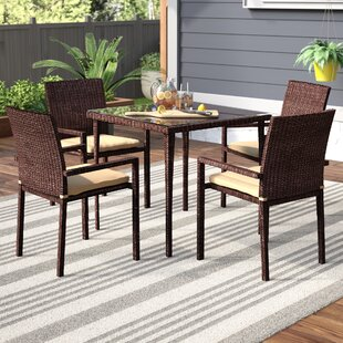 Basinger 5 Piece Dining Set with Cushions..