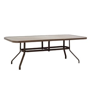 Palms Metal Dining Table by Outdoor Masterpiece