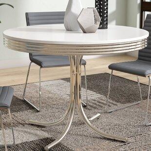 Kewei Retro Dining Table by Orren Ellis