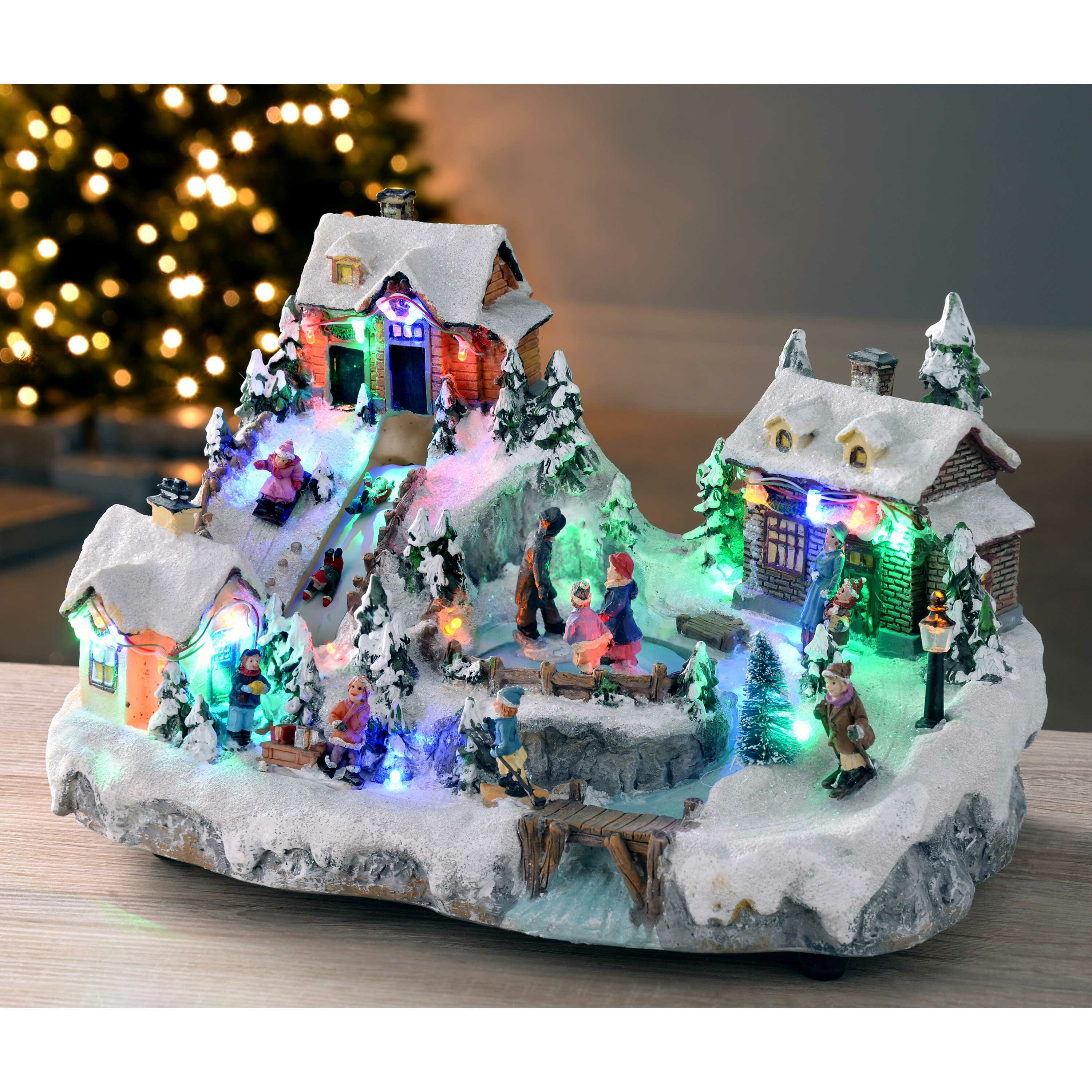 Christmas Ice Skating Rink Decoration.Animated Christmas Village With Moving Ice Rink And Slide Colour Led Lights