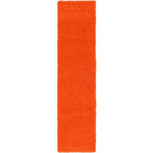 Angeline Orange Area Rug by Turn on the Brights