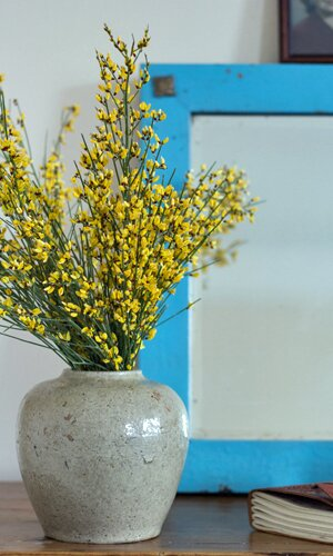 A closeup of the little flowers in the vase