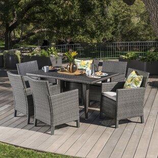 Orren Ellis Reidy Outdoor Wicker Rectangular 7 Piece Dining Set with Cushions