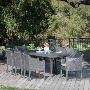 Orren Ellis Luebbert Outdoor 9 Piece Dining Set with Cushions