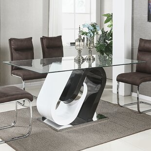 Orren Ellis Jigar Glass Top Dining Table