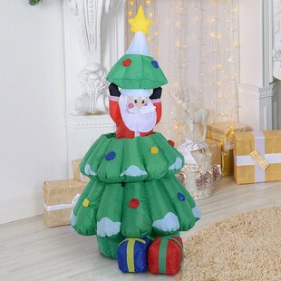 Inflatable Hidden Santa Claus In Xmas Tree By The Seasonal Aisle