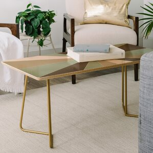Caroline Okun Champagne Coffee Table by East Urban Home