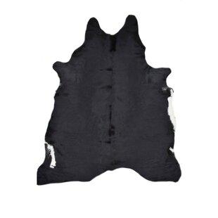 Cagle Cowhides Solid Black Area Rug
