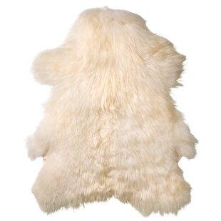 Find Creasey Faux Sheepskin White Area Rug ByGeorge Oliver