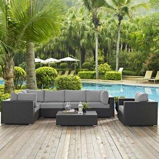 Brayden Studio Leda 7 Piece Rattan Sunbrella Sectional Seating Group with Cushions