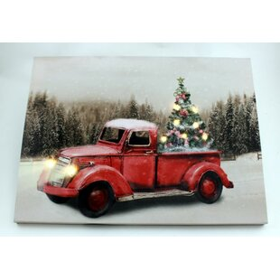 red truck and fibre optic led christmas tree photographic print on canvas