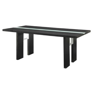 Dudek Dining Table by Orren Ellis