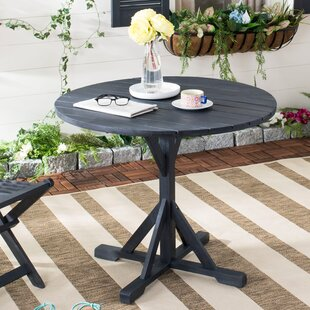 Babineaux Solid Wood Dining Table by Darb..