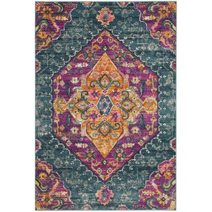 Esparza Orange Area Rug by Bungalow Rose