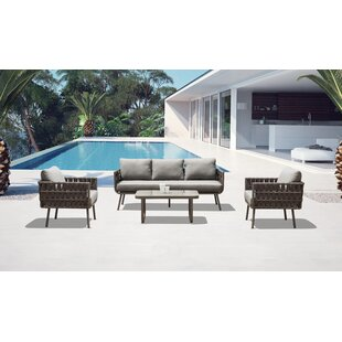 Delbert 4 Piece Rattan Sofa Seating Group with Cushions