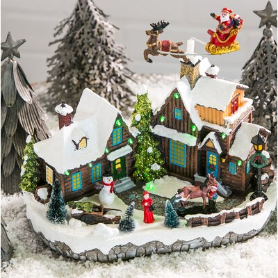 The Holiday Aisle Santa and Christmas Village LED Scene