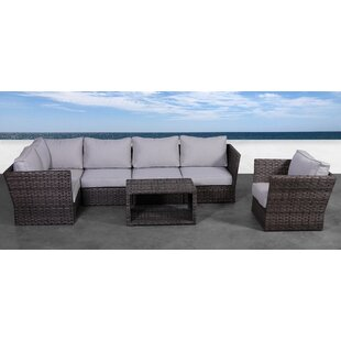 Cochran 7 Piece Rattan Sectional Seating Group with Cushions