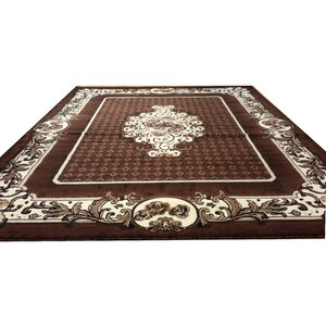 Hand-Carved Brown Area Rug