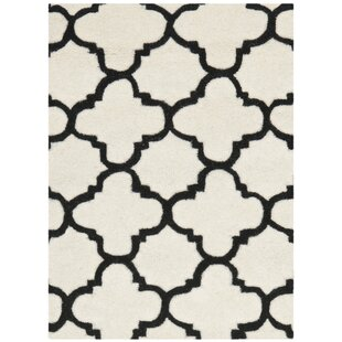 Revis Hand-Tufted Ivory/Black Area Rug by Safavieh