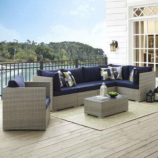 Heinrich 7 Piece Rattan Sunbrella® Sectional Set with Cushions