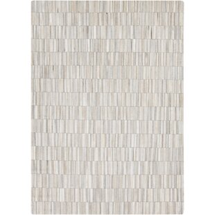 Look for Hinesville Handwoven Cowhide WhiteMedium Gray Area Rug By Greyleigh