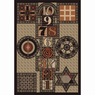 Joy Games Brown Area Rug By The Conestoga Trading Co.