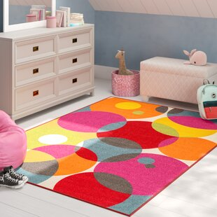 Eddie Circles Pink/Red Area Rug by Viv + Rae