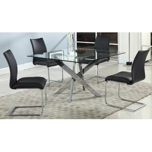 Tajana Dining Table With Glass Top by Orren Ellis
