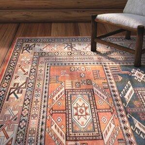 barium orange area rug