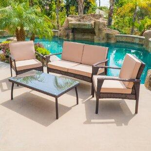 Stockwood 4 Piece Conversation Set with Sunbrella Cushions