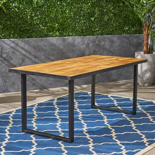 Tunis Solid Wood Dining Table by 17 Stories