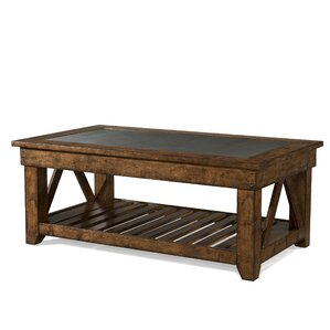 Peatman Rectangular Coffee Table with Magazine Rack by August Grove