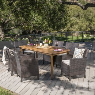 Gracie Oaks Pilger Outdoor Wicker Rectangular 7 Piece Dining Set with Cushions