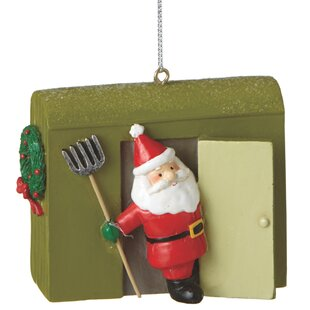 santa with ice house ornament by the holiday aisle