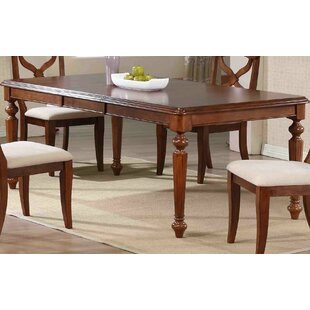 August Grove Kenya Solid Wood Dining Table