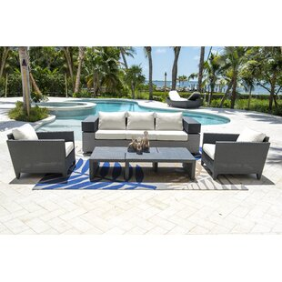 Onyx 4 Piece Rattan Sunbrella Sofa Seating Group with Cushions by Panama Jack Outdoor