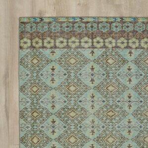masmoudi handknotted turquoise area rug