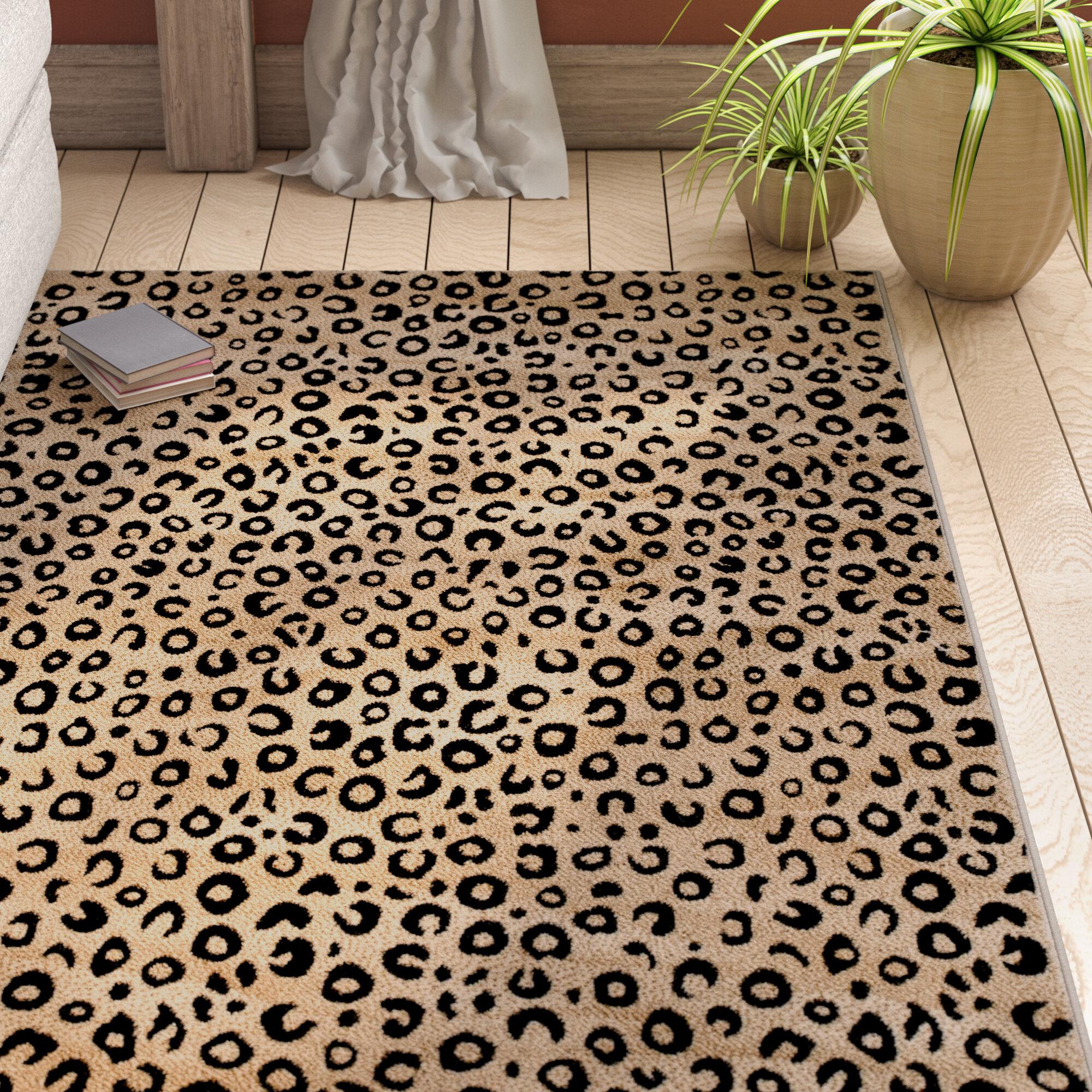 Poteat Animal Print Black Area Rug