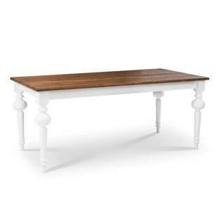Dunnes Solid Wood Dining Table by Alcott Hill