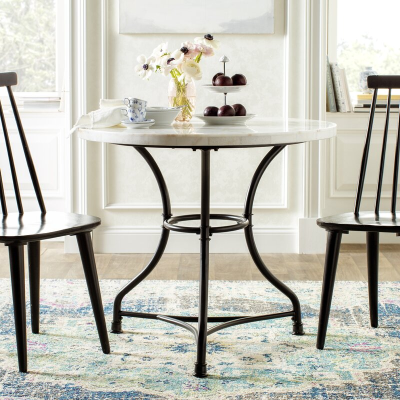 Moran Dining Table. See more lovely French inspired decor and furniture from Kelly Clarkson's collaboration with Wayfair in this story! #kellyclarksonhome #frenchcountry #diningtable #diningroomdecor #marbletoptable