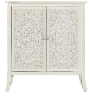 Whitt Antiqued Carved 2 Door Accent Cabinet