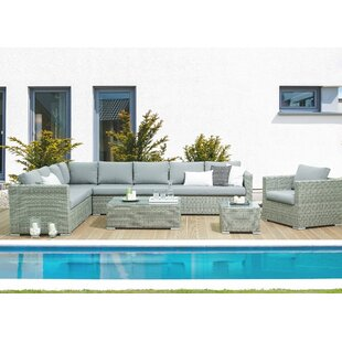 Brayden Studio Driscoll 4 Piece Rattan Sectional Seating Group with Cushions