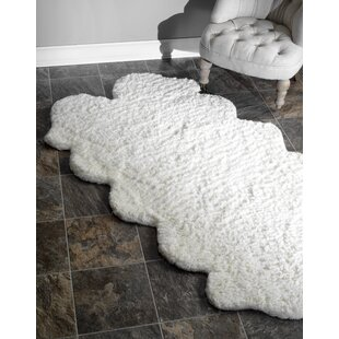 Look for Bigby Hand-Tufted Faux Sheepskin White Area Rug ByMercury Row