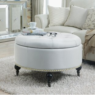 Letitia Round Storage Ottoman With Carved Wood Legs