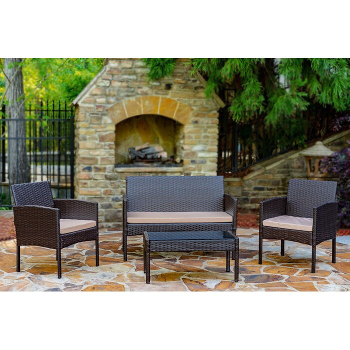 World Menagerie Tessio 4-Piece Rattan Seating Group Patio Set with Cushions