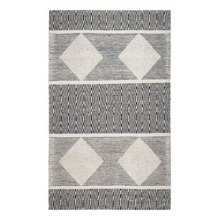 Find the perfect Hand-Woven Black/White Area Rug By Bloomsbury Market